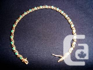 14-CARAT GOLD WITH EMERALDS - $175