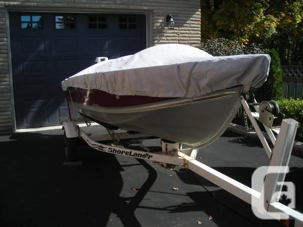 14' Lund Aluminum Boat, 25 HP Johnson outboard, Trailer