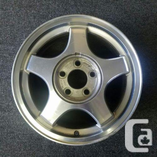 "2 - 16"" GM Alloy Rims with mounted tires. Fit"