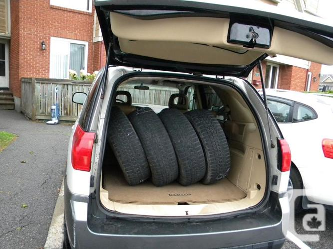 2003 Buick Rendezvous with 4 snow tires on rims