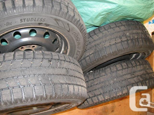 2007 Subaru Outback snow tires with rims.
