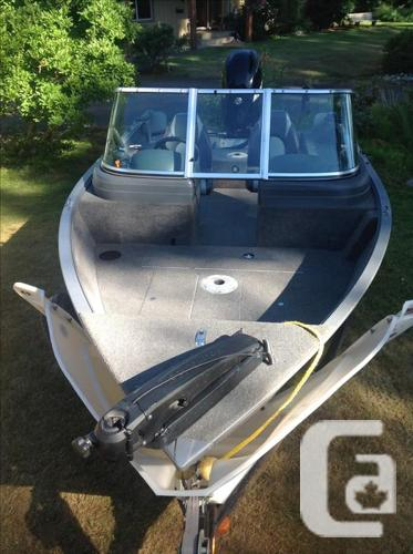 2008 Lund 16' 1/2 fter with 75 hp 4 stroke engine.