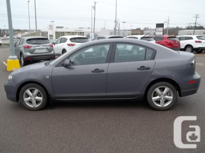 2009 MAZDA 3 GX WITH A/C AND AUTOMATIC