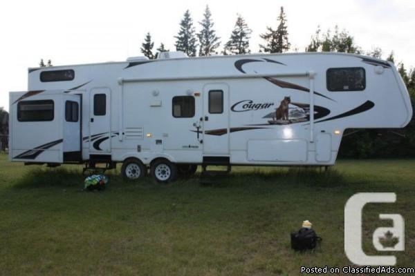 2010 Cougar 324RLB fifth-wheel Available