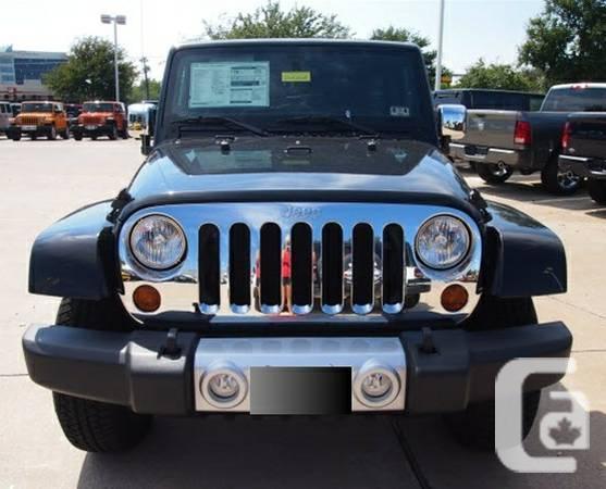 2013 Jeep Wrangler Unlimited Sahara - $34860