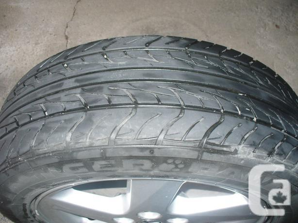 215/60/17 Uniroyal Tiger Paw AS65 All-Season Tires (not