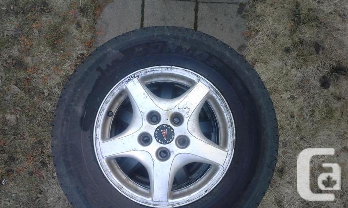 215/70 R15 Dunlop Signature Tires (on GM Rims)