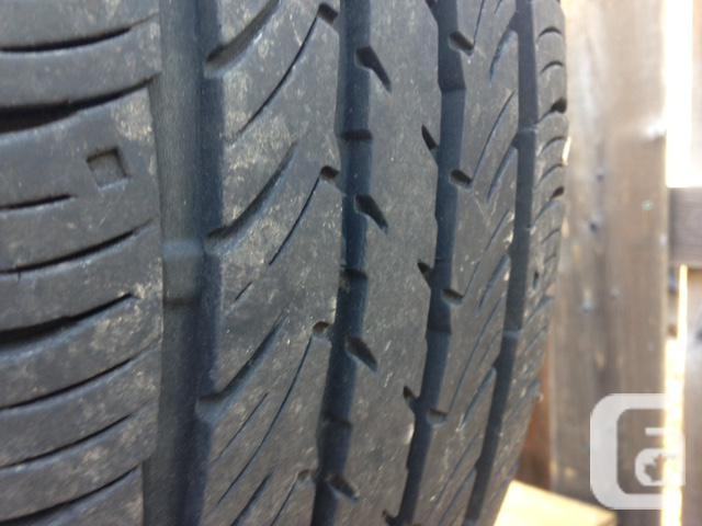 265/65R16 Falken All Season Tires on Alloy Rims (Dodge