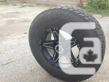 285/70 R17 Truck tires/black v-tec rims - $400