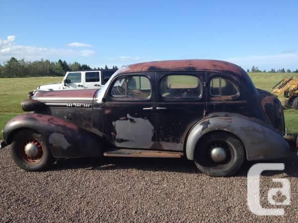 36 Olds 4 door touring car - $2500