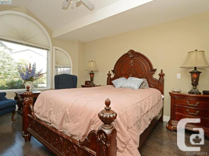 A guest bed and bath complete this lovely home