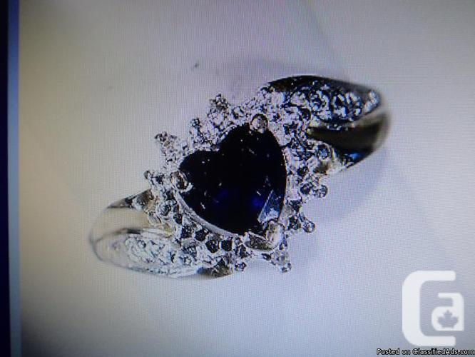 A VINTAGE Heart shaped Blue Sapphire Ring with Diamond