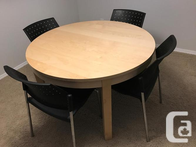 Beautiful tan colored extendable dining table