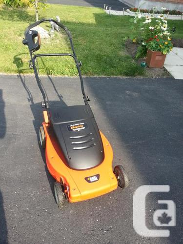 Black and Decker electric lawn mower.
