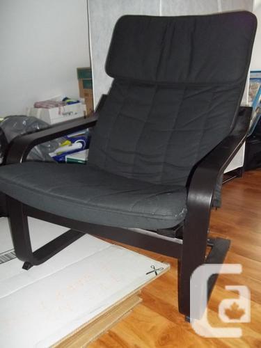 Black IKEA POÄNG chair and POÄNG footstool