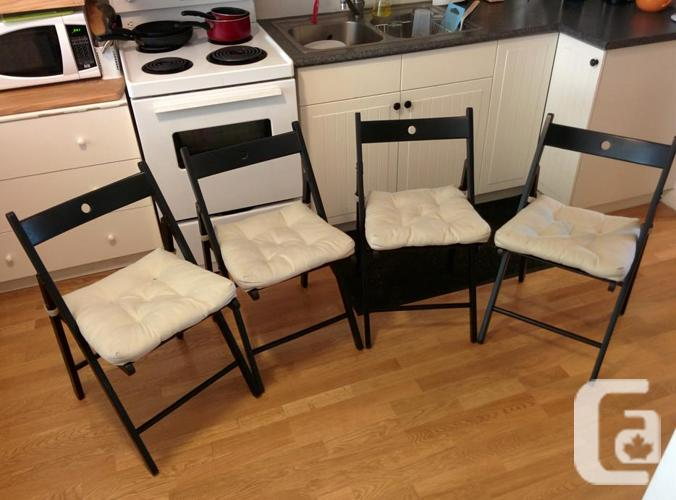 Black wooden folding chairs with cushions - great