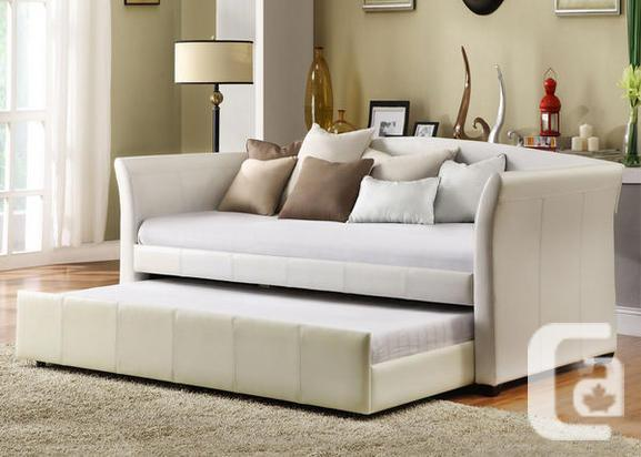 BRAND NEW BEAUTIFUL PU-LEATHER DAY BED WITH TRUNDLE,