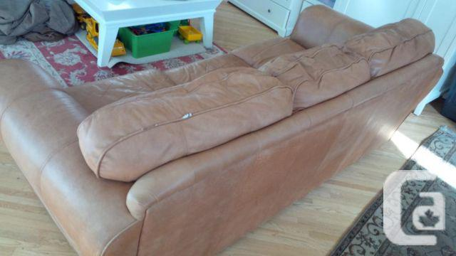 Brown leather couch with cover