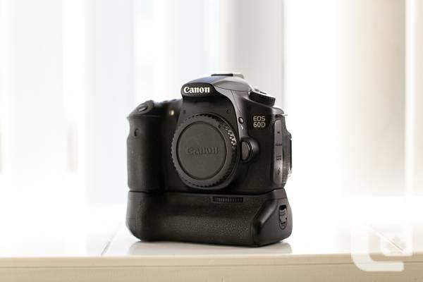 Canon 60D body + official grip - $550