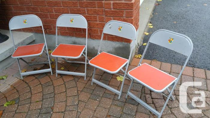 Classic solid wooden chairs and white plethar chairs