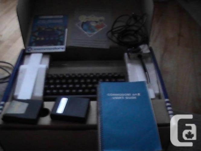 Commodore C64 with box, controllers, cables and more