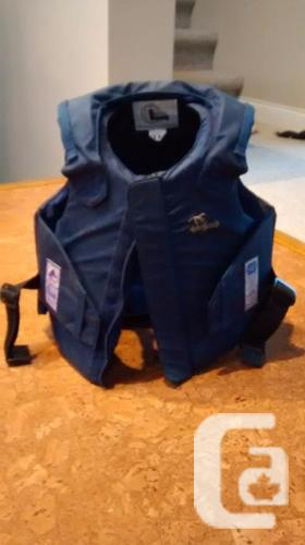 equestrian safety vest, breeches and half chaps