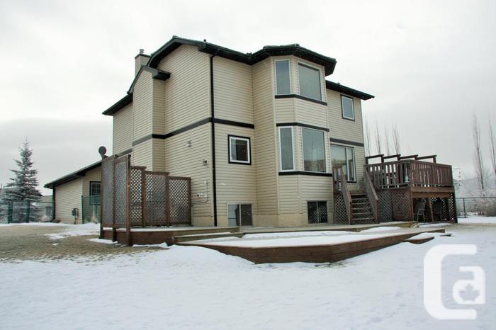 Fabulous Gleneagles Home Backing Onto Ravine - Cochrane