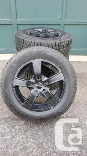 Four Hankook Winter I*Pike RS Tires on Momo Italy