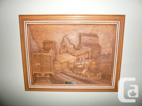 Four wood carving reproductions of trains for sale in