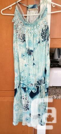 Genuine Roberto cavalli gown dimension s/m used once