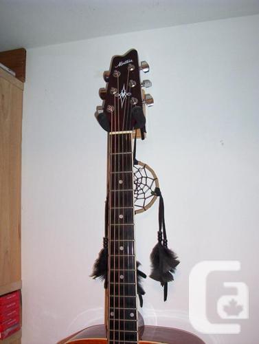 Guitar Solid top             case, capo, etc is extras