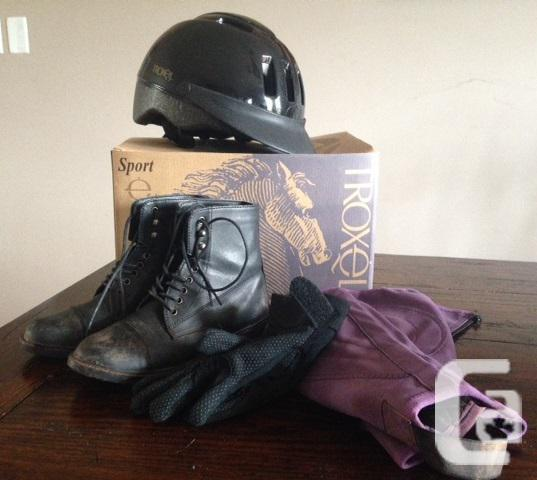 Horse riding helmet, boots, gloves, and chaps