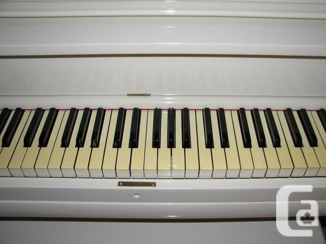 Ivory Upright Piano