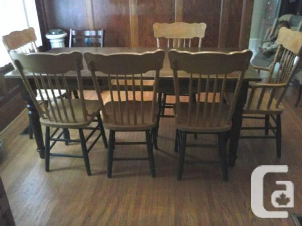 LARGE HARVEST TABLE AND 6 PRESS BACK CHAIRS - $850