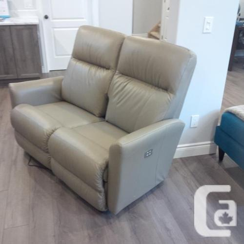 Lazy boy genuine leather reclining love seat. Brand new