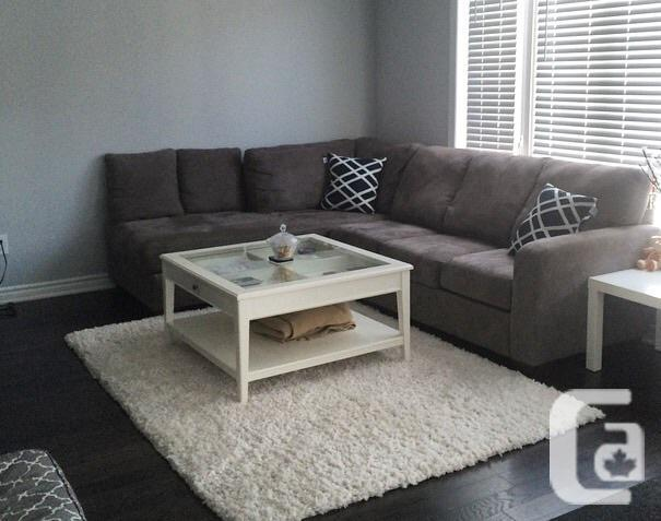 Like new Charcoal Sectional with matching cushions
