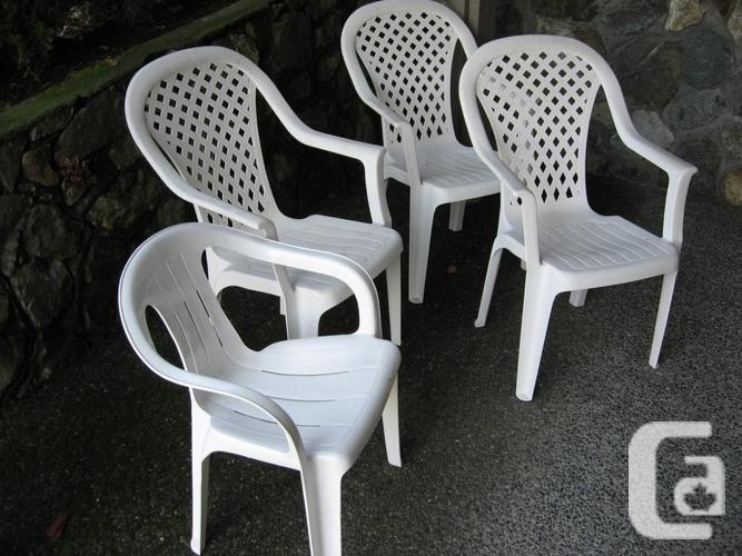 Lot of four 4 used white resin stacking outdoor chairs for Outdoor furniture victoria bc