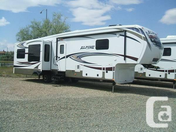 New Alpine 3535RE slip luxury that is quad fifth wheel