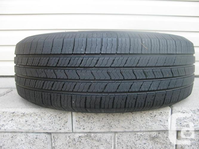 ONE (1) MICHELIN DEFENDER XT TIRE /215/60/17/ - $40