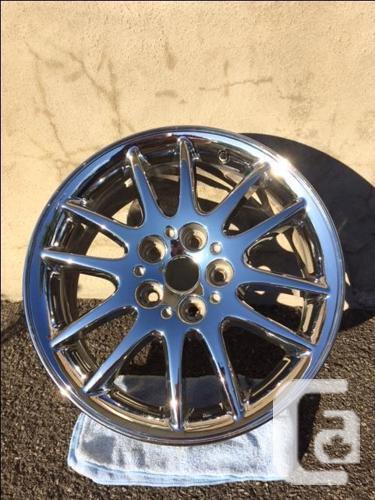 One Chrysler 17 inch (OEM) chrome rim for sale