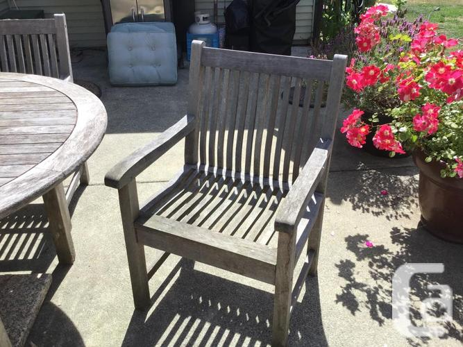 Outdoor teak dining table, 4 chairs and cushions
