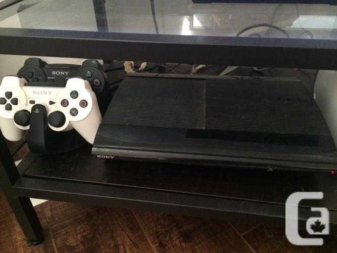 Playstation 3 (PS3) with 2 controllers, charging dock