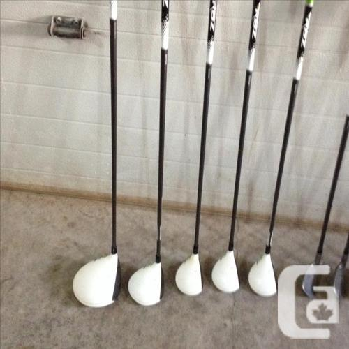 set of tailor-made rocket balls golf clubs with vokey