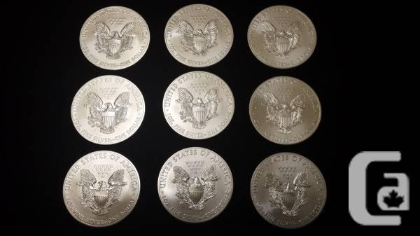 silver eagles .999 2014 bullion - $23