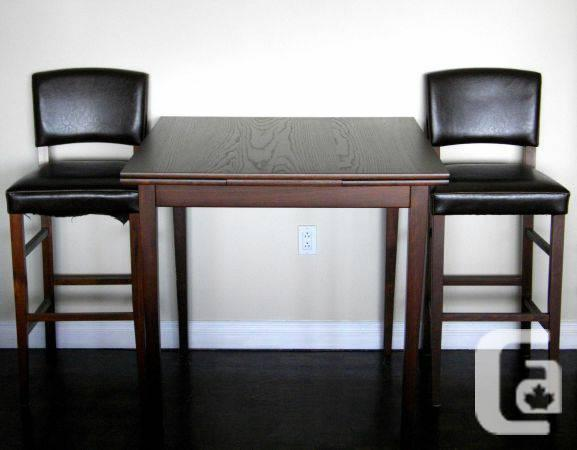 SOLID WOOD TABLE with extending leaves - $99