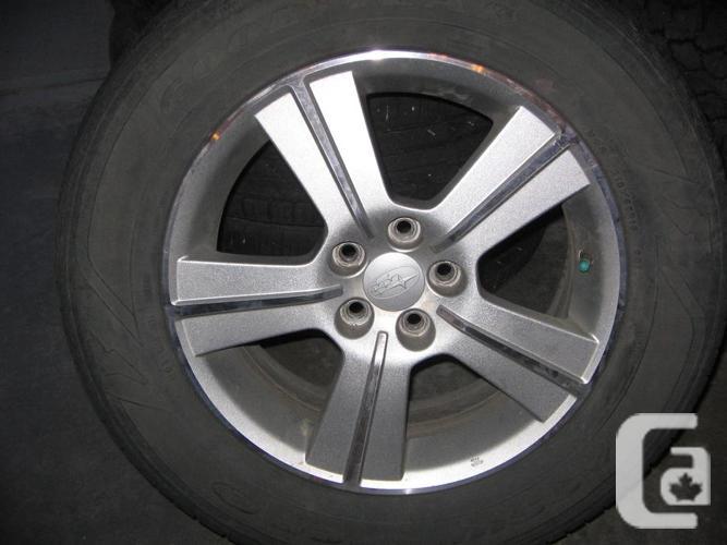 Subaru Aluminum Rims withe Good Year Assurance Tires