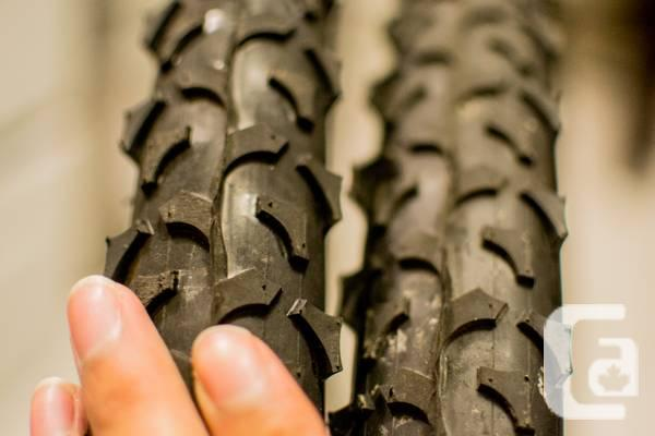 Two 26 x 1.95 Mountain bike tires/wheels with one rim -