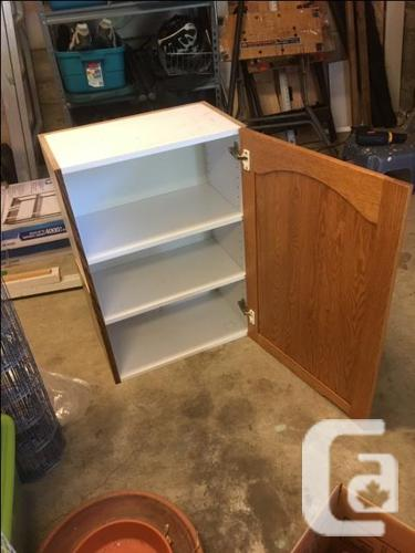 FREE: Two white pantries and two oak cabinets
