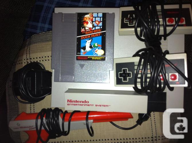 UNIQUE Nintendo System. 2 controllers, 1 Sport, 1