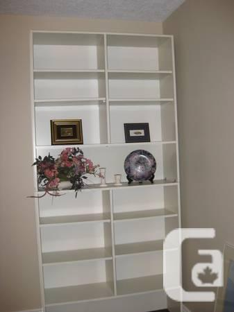White solid shelves can be separated in two shelves